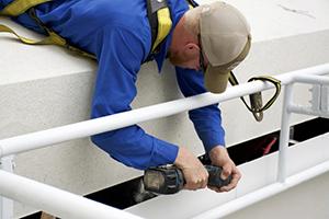 GutterItUp-employee-installing- comercial gutters